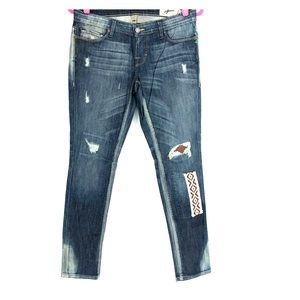 Free People medium wash distressed, patched jeans